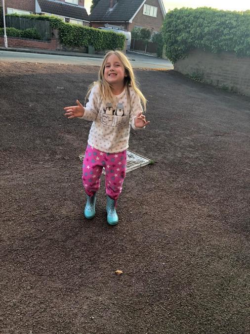 Dancing in her wellies!