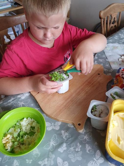 mixing cress with egg