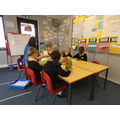 Mrs Hill reading with some children in Year 1...