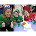 Mrs Dyson and some pupils in Year 1 enjoying today's Christmas lunch!