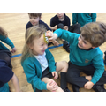 We practised using cold compresses for head bumps.