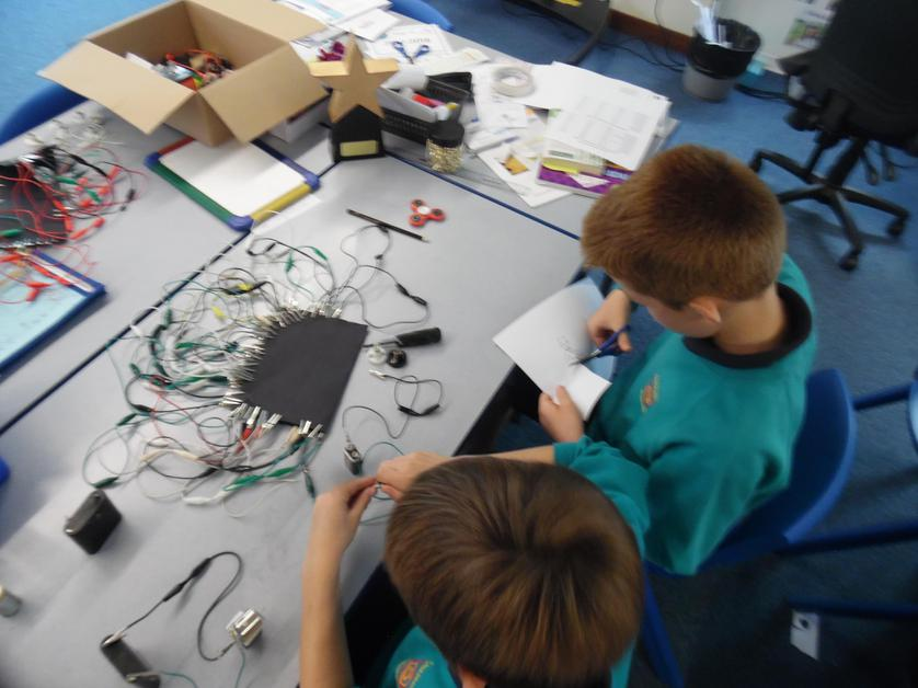 Creating our own switches using paperclips.