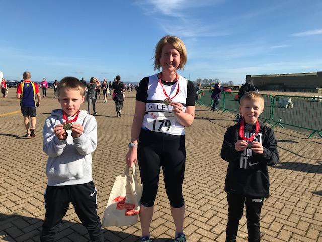 Joseph, Miss Hind and Ted with their medals