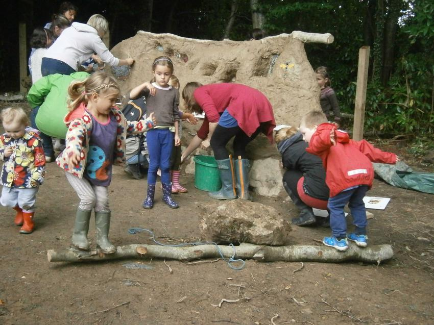 Everyone getting stuck in to build our cob bench