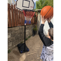 Kian playing basketball