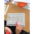 Recording our numbers in a place value chart.