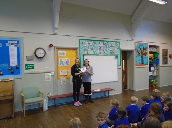 Mrs Vile receiving the School Games Mark - BRONZE