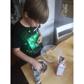 Tyler is learning new cooking skills.