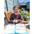 Caitlin completing some home learning in the sun!