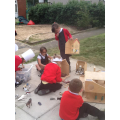 Role play with farm animals in the outdoor sandpit