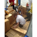We built our own garage with wooden blocks!