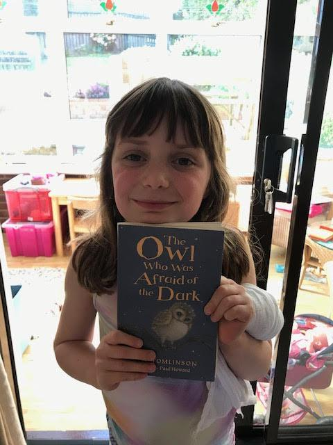 E. reading 'The Owl who was Afraid of the Dark'