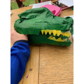 Making a milk carton dinosaur