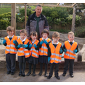 Rabbit Class - Cleaning round the sandpit 19/4/16