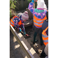 Badger Class - cleaning round the sandpit 7/3/16