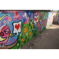 Our colourful graffitti wall by the Year 1 classes