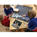 Using collage to recreate the moon on our giant front cover!