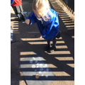 Creating lots of stars by splatting paint over the top of our chalk!