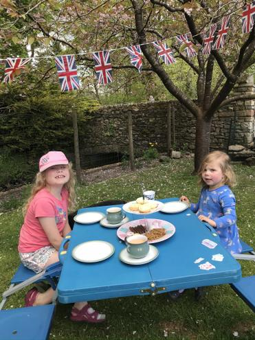 Tea party in the garden listening to wartime songs