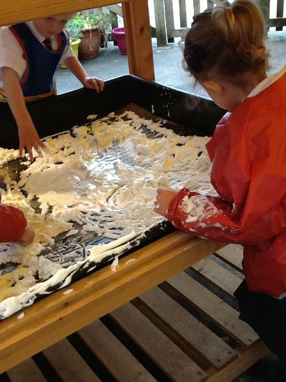 Writing letters in the foam.