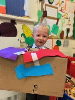 Using recyclable materials we made houses for Ted.