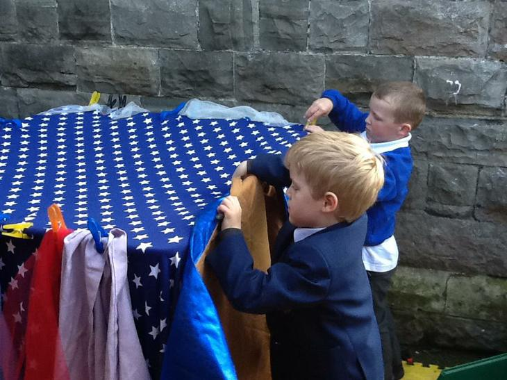 Building a den for the three little pigs.