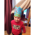 Connor decorated a crown using different coloured paint.