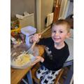 Jack enjoyed baking cakes with his mummy.