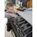Connor is finding cutlery for lunch