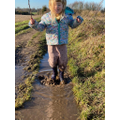 Edie loves jumping in the muddy puddles!