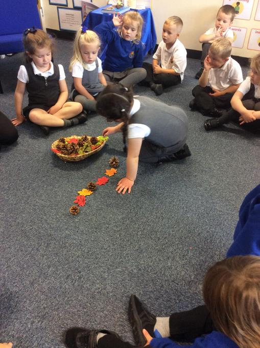 Creating repeating patterns in Maths using autumnal objects.