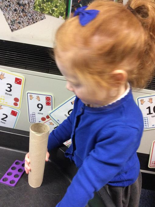 Emilia counted how many conkers would fill the tube.