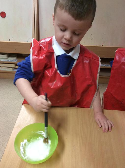 Jase mixed icing sugar and water to make a syrup.