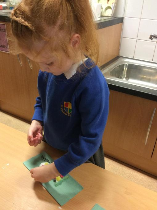Emilia made a biscuit for her friend.