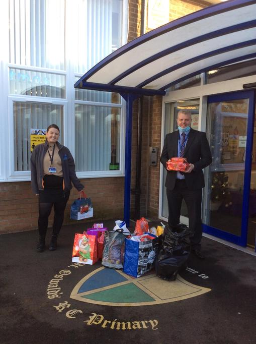 Mr Woodhouse handing over the donations to Mrs Elliott from The Key Project