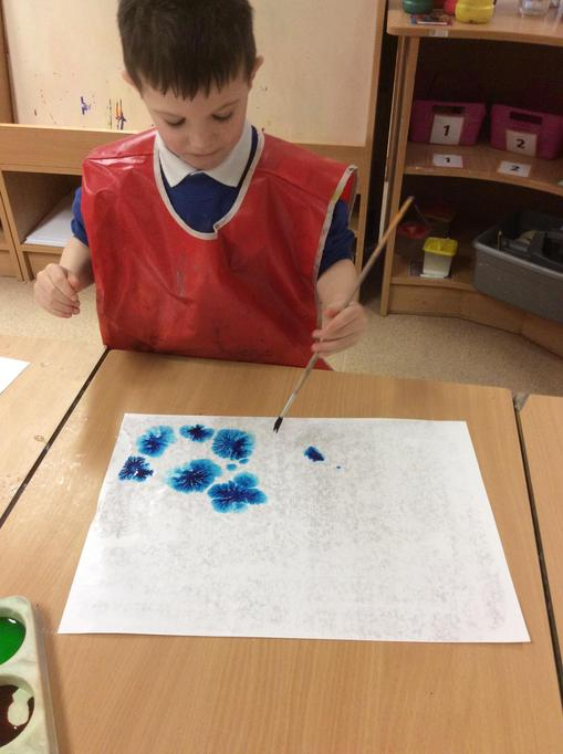 Charlie dropped the food colouring on to his paper.