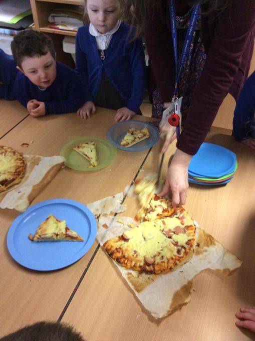 Miss Porter cut the pizza into slices!