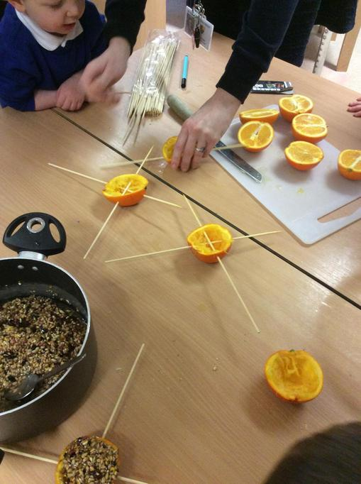 We slotted skewers through the oranges.
