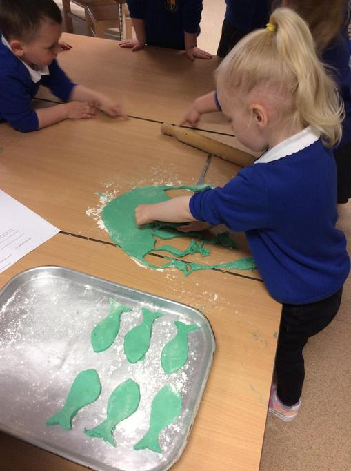 We rolled the biscuit dough and Leona pressed the fish cutter into it.