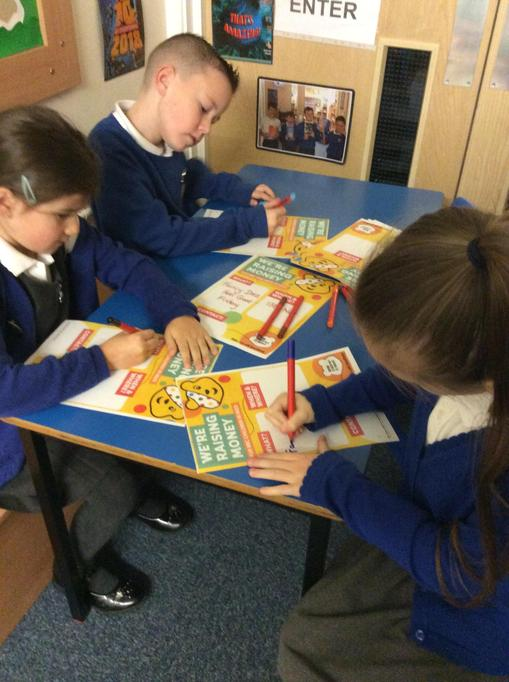 Year 3 and 4 making posters
