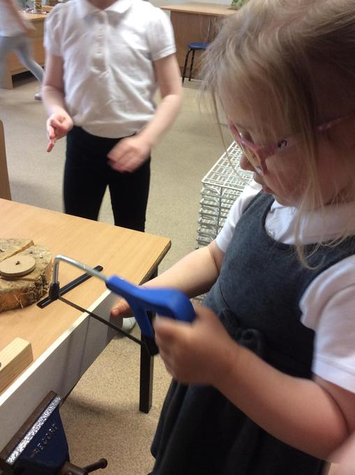 Ella remembered how to use the saw.