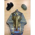 Egyptian artefacts: Tutankhamun's Death Mask, Scarab beetle,Sphinx.
