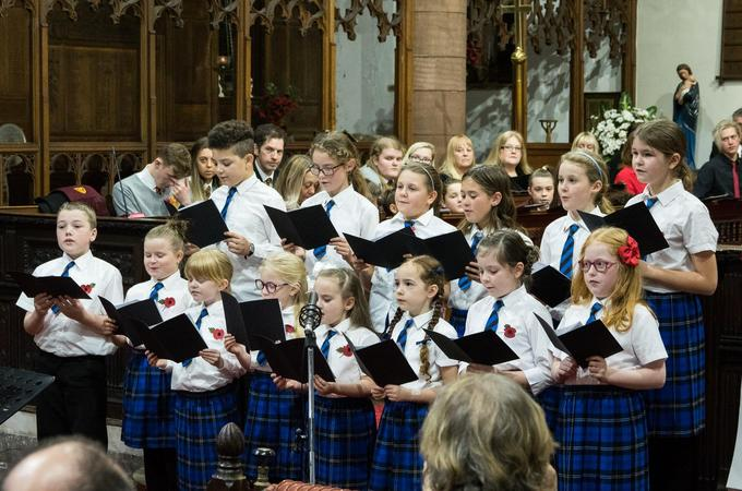 Our School Choir, taking part in a charity concert at our local Church