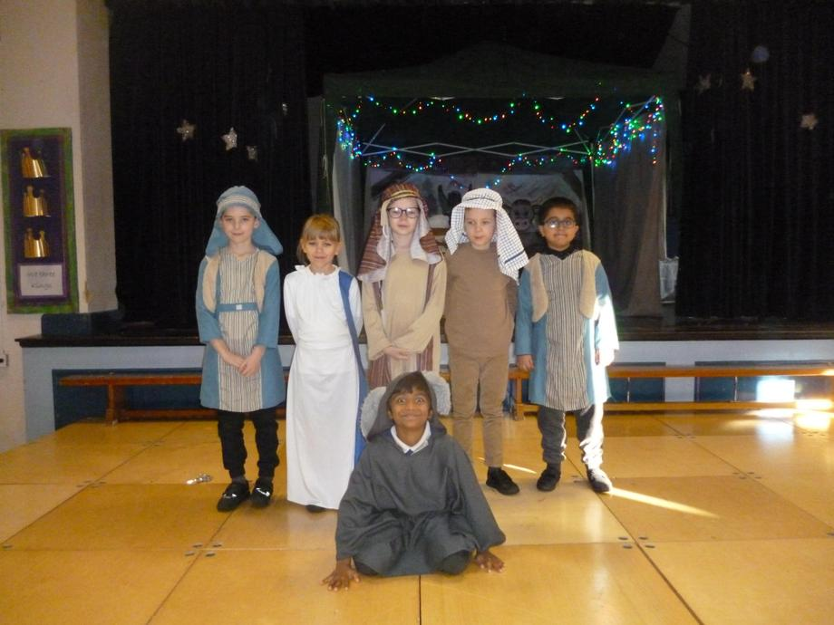 Mary, Joseph and the donkey meet the innkeepers