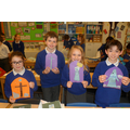 The children holding their finished designs.