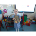 Freya with a topic-related book from the library.