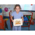 Klara with an Egyptian artifact.