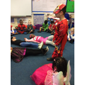 Acting out parts of the story from Traction Man