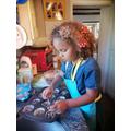 Zuri enjoying making cakes.