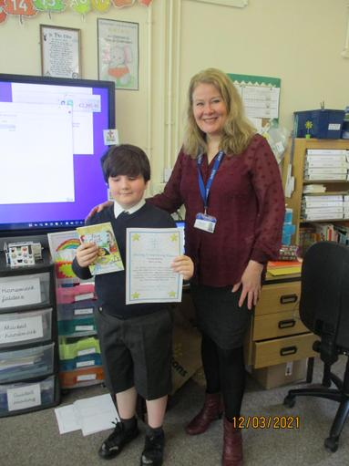 One of the winners of our whole school writing competition. A budding author!